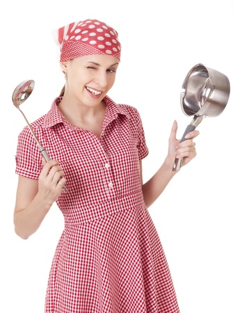 Playful housewife with ladle and pan photo