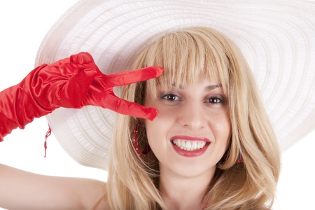 brigh: Playful fashion girl in retro style with bright make-up and big hat on white background