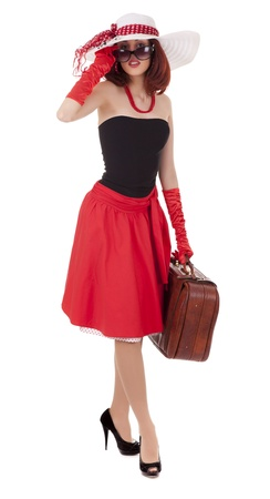 Full-length girl in retro style with suitcase and big hat on white background photo