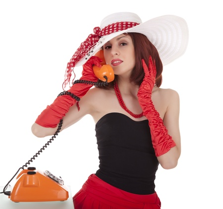 Fashion girl in retro style with vintage phone on white background photo