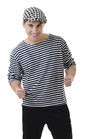Thumbs up! by look naughty handsome young man in stylish striped dress and cap with suitcase Stock Photo - 11140719