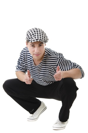 Thumbs up! by look naughty handsome young man in stylish striped dress and cap with suitcase photo