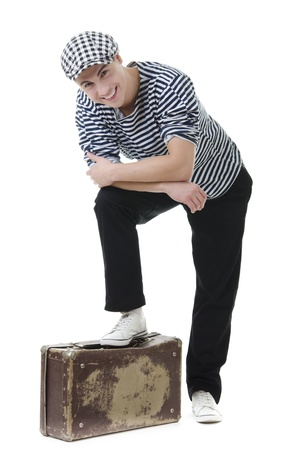 Look naughty handsome young man in stylish striped dress and cap with suitcase photo