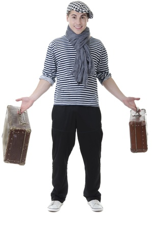 Look naughty handsome young man in stylish striped dress and cap with suitcases photo