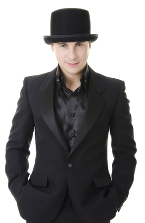 austere: Young attractive man in black suit and hat in austere style isolated on white background