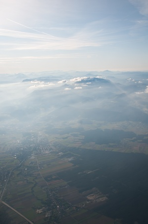 Aerial view of Alps above cloudscape and mountains photo