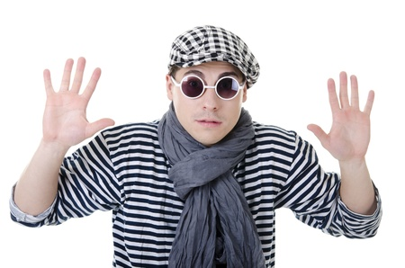 yielding: Yielding naughty handsome young man in stylish striped dress, glasses and cap with suitcase