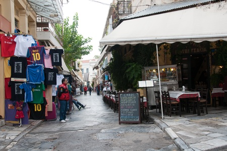 ATHENS GREECE - 15 OCTOBER 2011: Athens narrow street with shops and restaurants, old town - Plaka