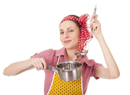 Playful housewife with ladle and pan on white background photo