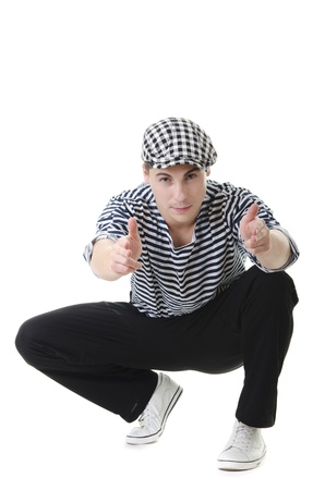 I shoot you! by look naughty handsome young man in stylish striped dress and cap photo
