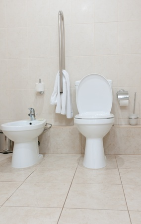White clean toilet bowl and bidet in modern  bathroom photo