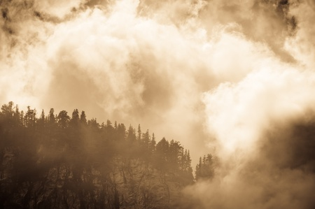 crown spire: Mountain peak shrouded in clouds
