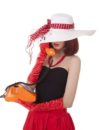 Fashion girl in retro style with vintage phone photo