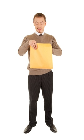 Young man opens a post package photo