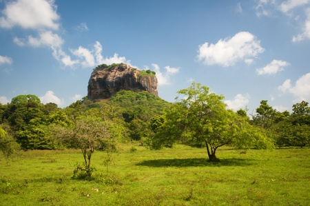 Sigiriya (Lion's rock) - ancient rock fortress in Sri Lanka, surrounded by an network of gardens and reservoirs photo