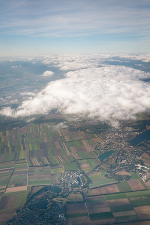 Aerial view of Austria above cloudscape and fields photo