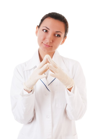 Thoughtful nurse in gloves isolated on white background photo