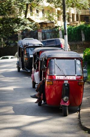 tuktuk: Kandy, Sri Lanka - December 8, 2011: Tuk-tuk is the most popular transport type on Asian streets.  .