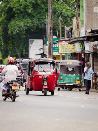 tuktuk: Bendota, Sri Lanka - December 14, 2011: Tuk-tuk and motobikes are the most popular  transport types on Asian streets.  .