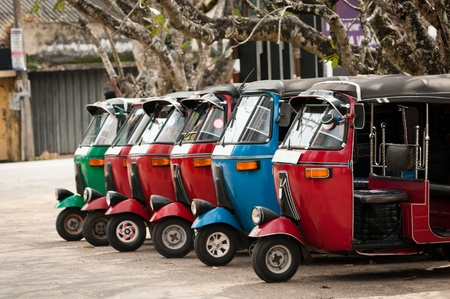 Tuk-tuk is the most popular transport type on Asian streets.  . Stock Photo