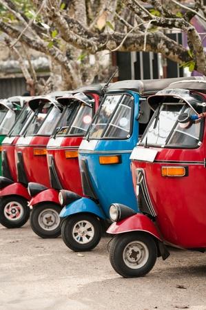 Tuk-tuk is a popular asian transport as a taxi  Stock Photo