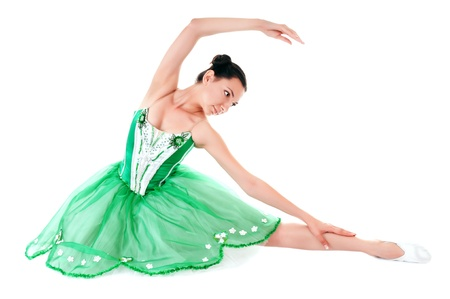 Exercising ballerina in green dress isolated on white background photo