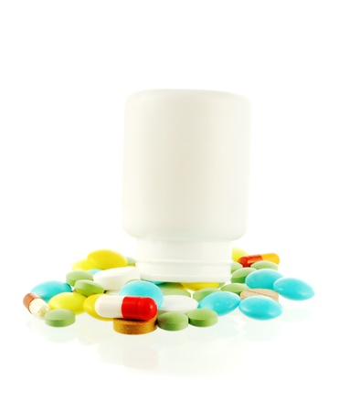 Bottle with falling out pills photo
