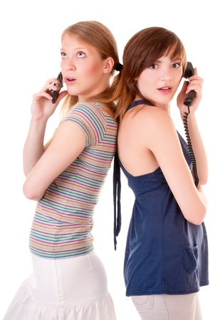 Two friends communicate by phones photo