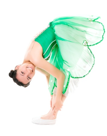 Exercising cheerful ballerina in green dress isolated on white background Stock Photo - 12828976