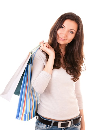 unworried: Woman holding shopping bags on white background