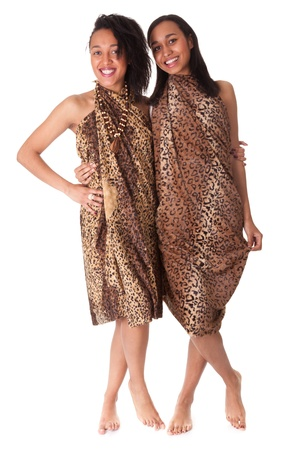 only 2 people: Two barefoot girls in animal print isolated on white background Stock Photo