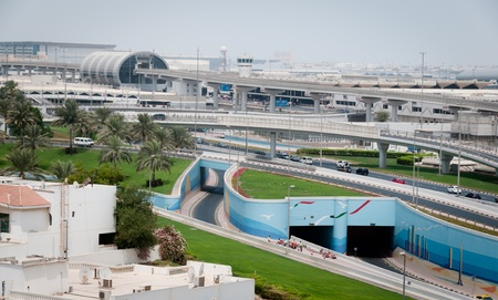 Dubai, UAE - August 29, 2011: International airport in Dubai and automobile roads to terminals, viev from the city