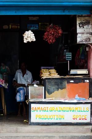 Bentota, Sri Lanka - December 14, 2011:  Asian man sell spicery in traditional asian open shop Stock Photo - 13257748