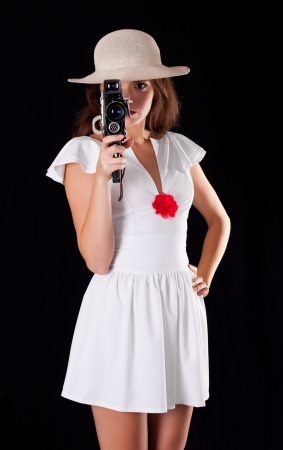 Young woman with vintage camera photo