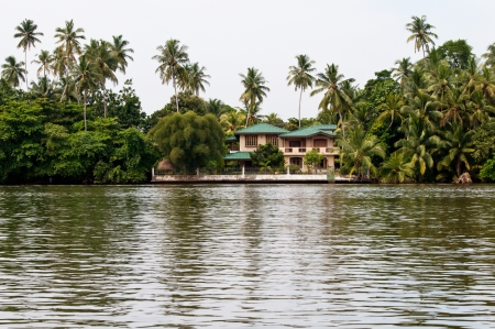 Contemporary building in jungle with big river on front photo