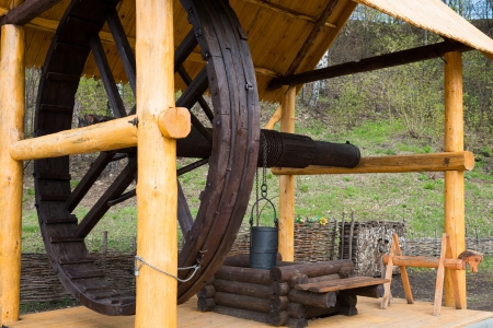 draw well: Vintage Slavonic traditional big wooden draw well with huge wheel and bucket