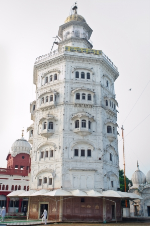 Gurdwara Baba Atal Sahib is the nine-storey octagonal tower, 40 metres high, is the tallest building in Amritsar   It is part of The Harmandir Sahib Complex, the spiritual and cultural center of the Sikh religion   Stock Photo - 14178911