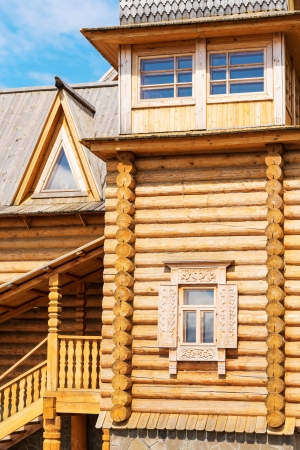 Wooden blockhouse with decorated windows, Russian traditional architecture  photo