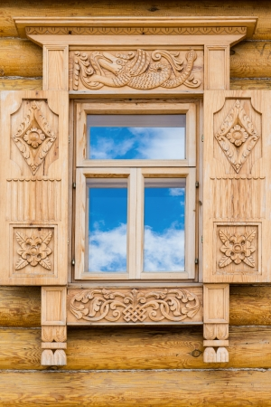 Wooden decorated window in log house, Russian traditional architecture  photo