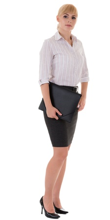 Full-length serious woman in elegant formal style with a folder photo