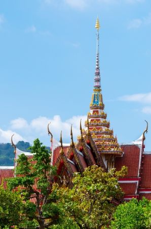 buddhist temple roof: Buddhist temple roof with blue sky and green trees
