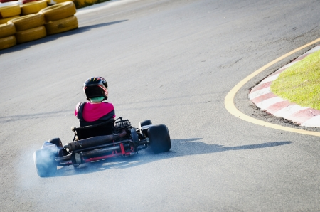 Karting - driver in helmet rushes on kart circuit