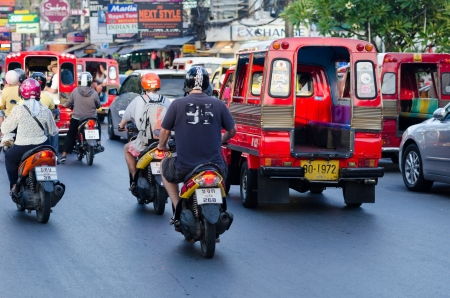 Patong, Phuket, Thailand - January 16, 2012: Intensive traffic on Patong street with taxi, motorbikes, cars in high tourist season