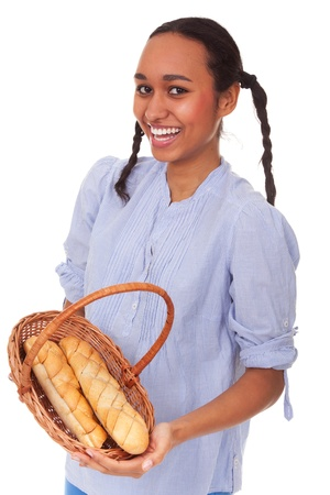 Nice multi-ethnic girl with bread in basket isolated on white background photo