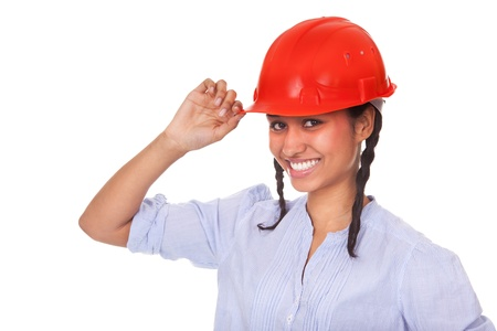 Nice multi-ethnic girl in red hard hat isolated on white background photo