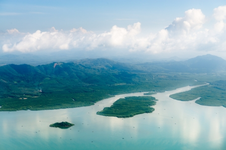 Aerial view of mangrove forests in blue water of Andaman sea photo