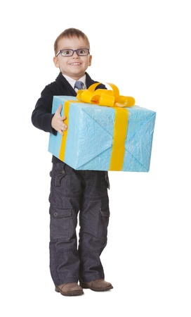 Small happy kid in spectacles with big present on white background
