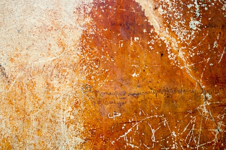 sanskrit: Ancient wall on Sigiriya rock in Sri Lanka with romantic verses in ancient language