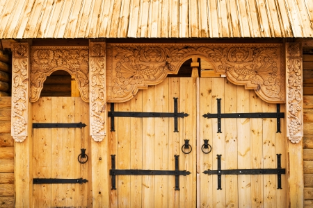 Wooden gate richly decorated with mythology images photo