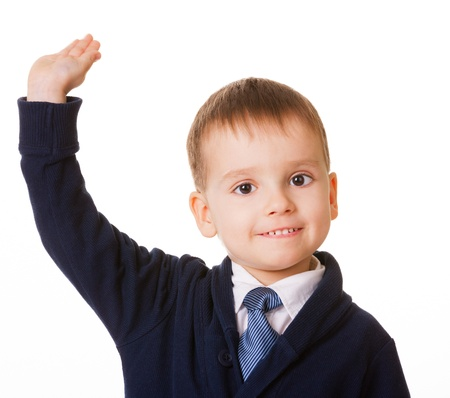 raises: Small schoolboy raises his hand for answer, isolated on white background